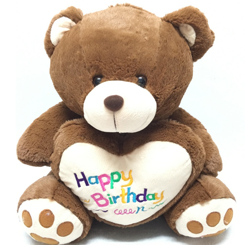 brown color teddy bear with happy birthday text on heart
